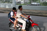 whole family on a motorbike and no helmets!