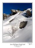 Snow Piled Against Rocky Knob.jpg