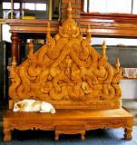 Dog on carved bench