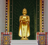 Small Buddha image outside temple