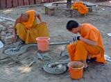 Monks doing restoration work