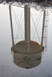 Former (as in not used anymore) water tower reflected on surface water