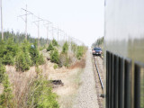 Maintenance vehicle following mixed train south of Moosonee