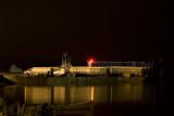 Trucks aboard a barge in Moosonee
