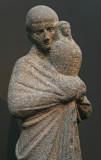 Statue d'un prêtre portant Osiris