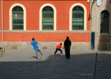 Playing pelota in the wall of the market