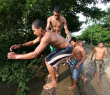 Boys Jumping Into The River