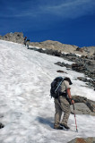 Hikers Heading Up Snowfield