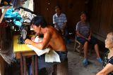 0045 Village tailor.