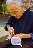 0293 Village elder making netting.