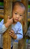 3077 Kam child near outdoor butcher.