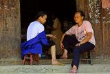 3689 Two Kam elder woman visiting.