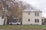 Side of W Neely home and backyard taken from 700 block Elsbeth