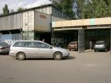 Car at little mechanic workshops after clutch went entering Almaty