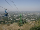 Looking down to Almaty from Kok-Tube hill. Tall building right of centre is Hotel Kazakhstan