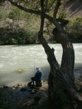 OLd lady fishing in the Charyn River