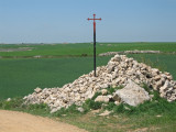 Cairn and pilgrim cross near San Bol
