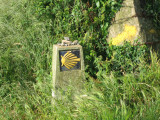 Typical Galician camino marker and yellow arrow