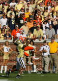 Clemson WR Aaron Kelly leaps to haul in a pass…