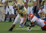 Yellow Jacket FB Mike Cox digs for extra yardage