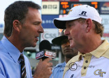 Georgia Tech Coach Chan Gailey is interviewed by ESPN at mid-field after the victory over #13 Clemson