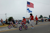 A young Fin riding for his people in the Newberry parade. This same photograph can be seen in our, Newberry Michigan gallery.