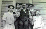 Apparently the man liked both children, & cats. This is an original photograph of William John Whiston Merrill & four of his daughters. Shown left to right are: Cora, Bessie, William, Daisy, & Ruth Merrill, taken in Crete, Saline County Nebraska circa 1910. This original photograph was given to me by my grandmother Hazel Alice Merrill. I am in possession of the original photograph. William was bon in Etobicoke, York, Ontario, Canada. He married Lillian Elizabeth T. Walker in Lincoln, Lancaster County Nebraska on 10 February 1883. Together this couple would have 12 children, the third of which was my great paternal grandfather; LeRoy Charles Merrill.