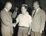 Roy Merrill was one of my paternal great grandfathers. He was also head custodian at the Nebraska Capitol Building for almost forty years. Here in this photograph we can see him shaking hands with then President Ike Eisenhower. Standing right is the then Nebraska Governor, Val Peterson. The original photograph shown was given to me by my grandmother, Hazel Alice Merrill. I am in possession of it still. This original photograph has Ike's signature attached in marker.