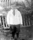 Verne was the youngest of three children born to LeRoy Charles Merrill & his wife, Dorothy Mae Bishop Merrill. On 16 June 1940 in Lincoln, Lancaster County Nebraska, he married Joyce Gannon. Together this couple would have one child, who died of polio at the age of five. Verne was a decorated Veteran of World War II, being wounded twice. The original photograph shown was given to me by my grandmother, Hazel Alice Merrill. I am in possession of it still.