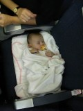Angelica sleeping on the plane back to Denmark