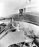 1947 - June Knight christening National Airlines DC-6