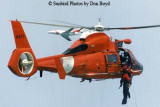 1996 - USCG HH-65 #6577 performing a hoist demonstration at the 1996 Air & Sea Show