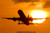 2007 - American Airlines B757-223 takeoff at sunset airline aviation stock photo #3084