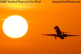 2007 - American Connection EMB-145 sunset aviation stock photo #3086