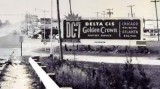 1955 - Delta C&S DC-7 Golden Crown billboard on NW 36th Street in Miami