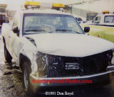 1991 - damaged ramp car after collision with Piper PA28-151 N41306 at Miami International Airport