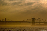 Brooklyn Bridge Under Clouds and Fog