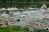 Fishing on a dam in the Stillwater River