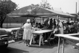 Bertha Puthoff (back to camera), Christine Harvey sitting at table
