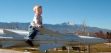 December 2006 - Kyler sitting on old Army missile with Pike's Peak in the background