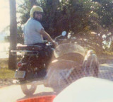 1976 - LCDR Clay Drexler on his motorcycle with sidecar