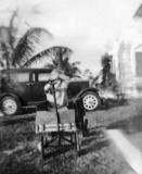 1936 - Burl Grey's younger brother in front of his dad's 1931 Graham car, 2123 NW 44 Street, Miami