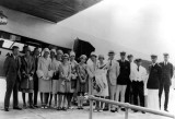 1929 - the Burdine Fashion Show group posing in front of a Pan American Airways System aircraft  in Miami