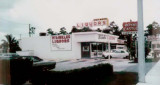 1972 - Weinkles Liquors and a Royal Castle sign at 12425 S. Dixie Highway, Miami