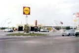 1965 - Uhligs' Shell gas station at 6700 Bird Road in front of the Kwik Chek shopping center, Miami