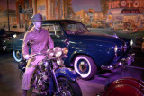 That's a 1950 Studebaker Champion Starlight Coupe behind the Harley.