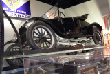 This 1926 Ford Model T is on its side in a 1923 Turn-Auto, used to get at the bottom of the car for repairs.