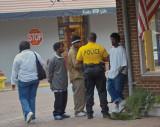 Foot patrol officer talking to teens