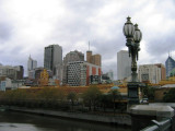 The CBD with Flinder Street Station in the foreground at a cold autumn day