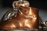 B: Bronze baby shoe